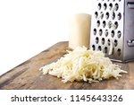 heap of grated mozzarella... | Shutterstock . vector #1145643326