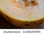 yellow cut in half fleshy juicy ... | Shutterstock . vector #1145645393