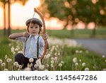 portrait of child playing with... | Shutterstock . vector #1145647286