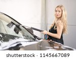 a blonde woman washing a suv car | Shutterstock . vector #1145667089