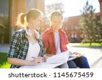 young happy students with books ... | Shutterstock . vector #1145675459