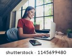 young  business woman sitting... | Shutterstock . vector #1145699480