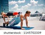 slim lady is motivating... | Shutterstock . vector #1145702339