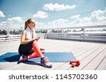 joyful young girl is relaxing... | Shutterstock . vector #1145702360
