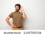 young dumb man paying attention ... | Shutterstock . vector #1145705156