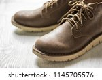 close up vintage leather shoes... | Shutterstock . vector #1145705576