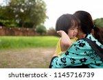 asian children feel sad to hug... | Shutterstock . vector #1145716739