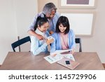 happy asian family reading and... | Shutterstock . vector #1145729906