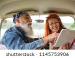 an old hipster couple on... | Shutterstock . vector #1145753906