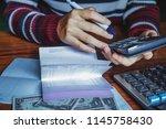 women is using a calculator to... | Shutterstock . vector #1145758430