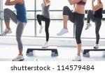 women raising their legs while... | Shutterstock . vector #114579484