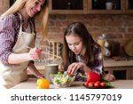moms little helper. kid girl... | Shutterstock . vector #1145797019
