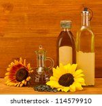 oil in bottles  sunflowers and... | Shutterstock . vector #114579910