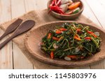 stir fried water spinach or cah ... | Shutterstock . vector #1145803976