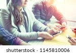 young people sitting using cell ... | Shutterstock . vector #1145810006