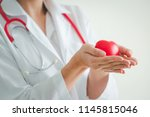 female medical doctor holding... | Shutterstock . vector #1145815046
