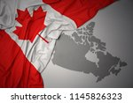waving colorful national flag... | Shutterstock . vector #1145826323