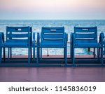 Mediterranean Sea and famous blue chais on Promenade des Anglais at sunset in Nice, Cote d