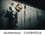 spooky doll hang on the wall in ... | Shutterstock . vector #1145843516