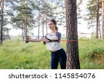 woman doing exercises in a park | Shutterstock . vector #1145854076