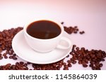 hot coffee and coffee beans on white background