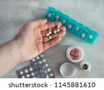 hand with pills and pillbox.... | Shutterstock . vector #1145881610