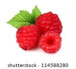 Sweet ripe raspberry with leaf - stock photo