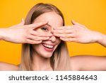 Stock photo closeup portrait of attractive cute straight haired blonde caucasian smiling girl hiding face 1145884643