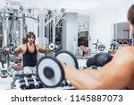 bodybuilder sitting on a bench... | Shutterstock . vector #1145887073