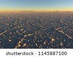 salar de uyuni at sunset  salt... | Shutterstock . vector #1145887100