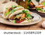gua bao  steamed buns with pork ... | Shutterstock . vector #1145891339