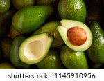 Bunch of green avocados. one of ...