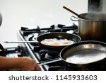 making delicious fried eggs in...   Shutterstock . vector #1145933603