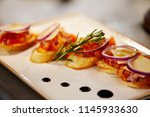 decorating the food in the... | Shutterstock . vector #1145933630