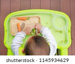 top view of infant baby eating... | Shutterstock . vector #1145934629