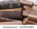 stacks of firewood.... | Shutterstock . vector #1145943083
