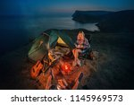 young couple backpackers... | Shutterstock . vector #1145969573
