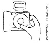 hand with camera photographic   Shutterstock .eps vector #1146006443