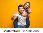 image of joyous couple showing... | Shutterstock . vector #1146012029