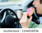 man is eating a sweet doughnut... | Shutterstock . vector #1146018536