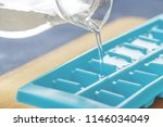 pouring water into ice cube... | Shutterstock . vector #1146034049