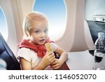 charming kid traveling by an... | Shutterstock . vector #1146052070