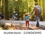 father and his little son...   Shutterstock . vector #1146063440