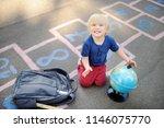 cute blond boy doing homework... | Shutterstock . vector #1146075770