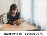 lovely woman reading a book by... | Shutterstock . vector #1146080870