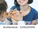 daughter holding fingers of... | Shutterstock . vector #1146103340