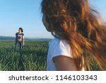 daughter looking at smiling... | Shutterstock . vector #1146103343