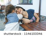mother and daughter playing at... | Shutterstock . vector #1146103346