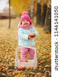 little girl with autumn harvest ... | Shutterstock . vector #1146141050