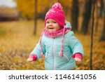 cute happy girl in autumn park | Shutterstock . vector #1146141056